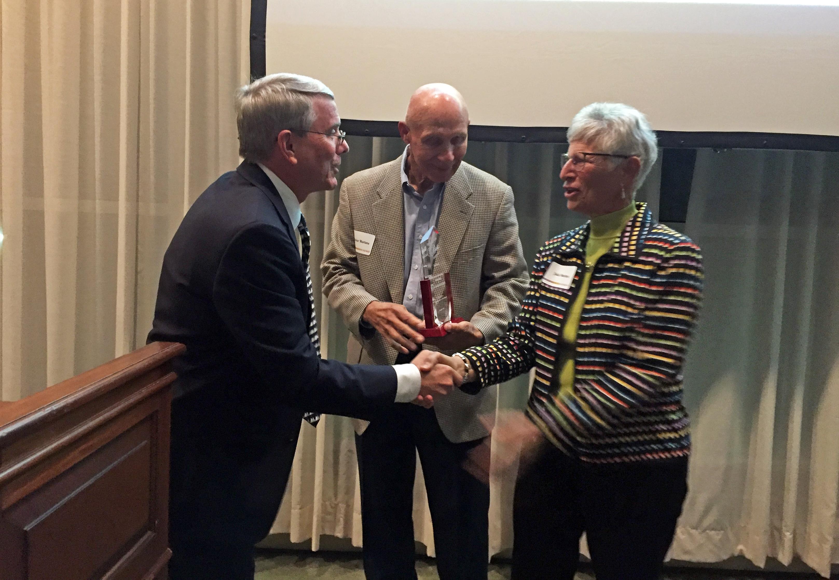 Commissioner Hays presents Partnership Award to Rainer and Julie Martens