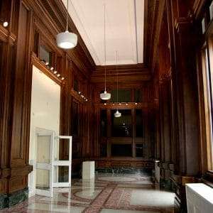Springer Cultural Center Historic Lobby: Decorative dark wood paneling cover walls with marble flooring.