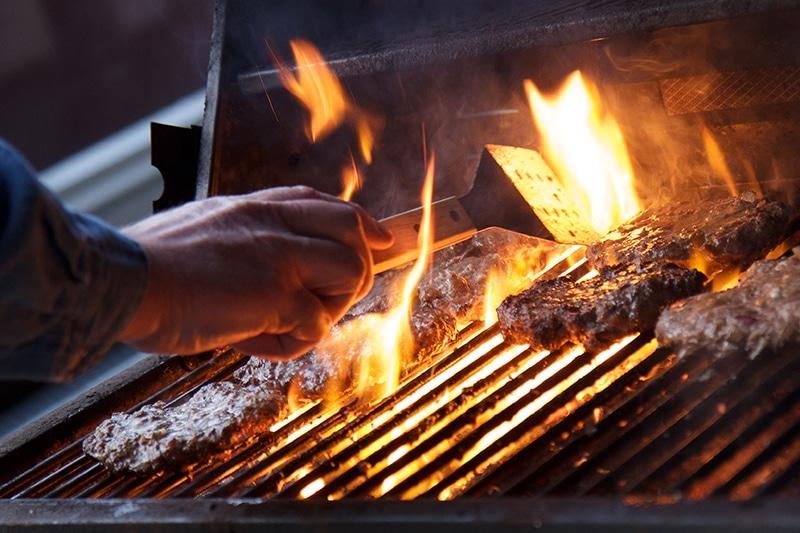 Fresh hamburgers being grilled.